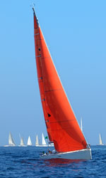 sailboat with a red sail